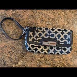 Authentic COACH wristlet/clutch (black and cream)